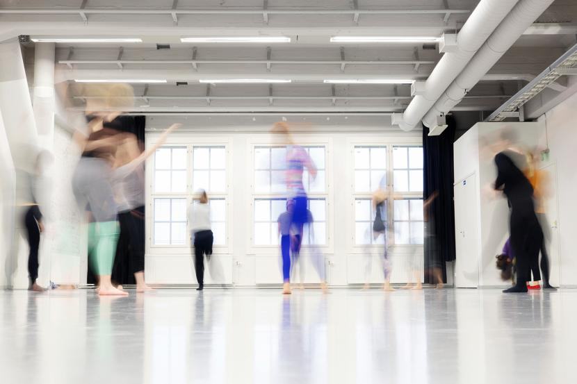 People moving in the dance studio
